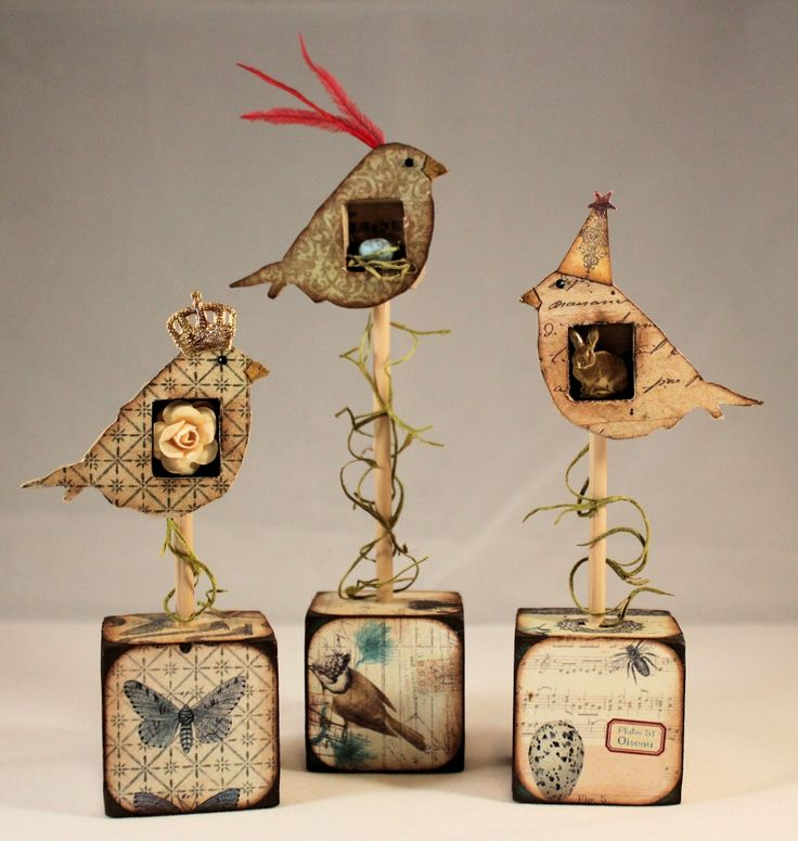 """Create 3 small birds, each with a niche holding a tiny treasure, in to a flock flying above 1.5"""" wood blocks. Used your mixed media skills for home decor."""