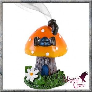 Orange Toadstool House incense cone burner. When the cone is burning, the smoke rises through the chimney of the item. Designed by Lisa Parker. A beautiful, detailed, fantasy pixies house incense cone burner. Approx 12.5cm tall. 3 vibrantly coloured designs to choose from. Included with this incense cone burner is a box containing 12 beautifully scented incense cones… WOW, what a deal!!