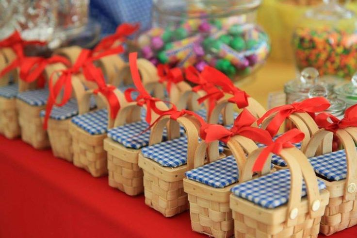 Cute gingham basket favors at a Wizard of Oz birthday party! See more party planning ideas at CatchMyParty.com!