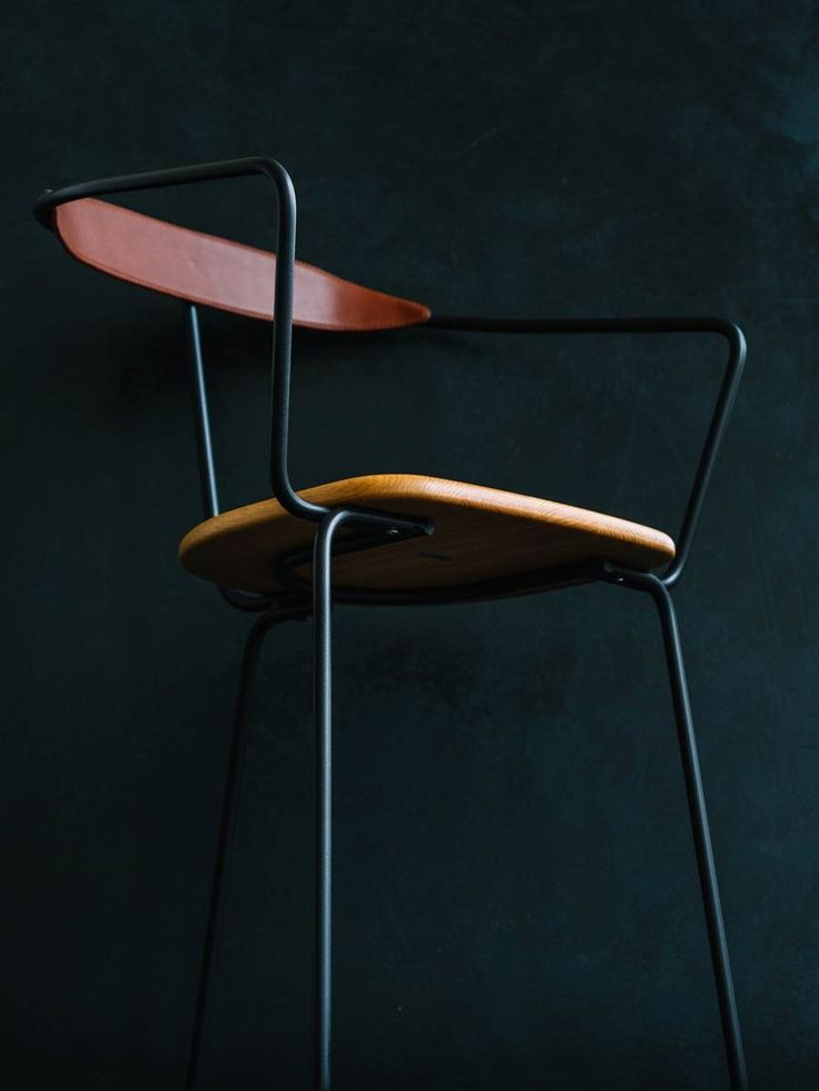 Ghost Chair black oak seat brown leather photo by Aiala Hernando