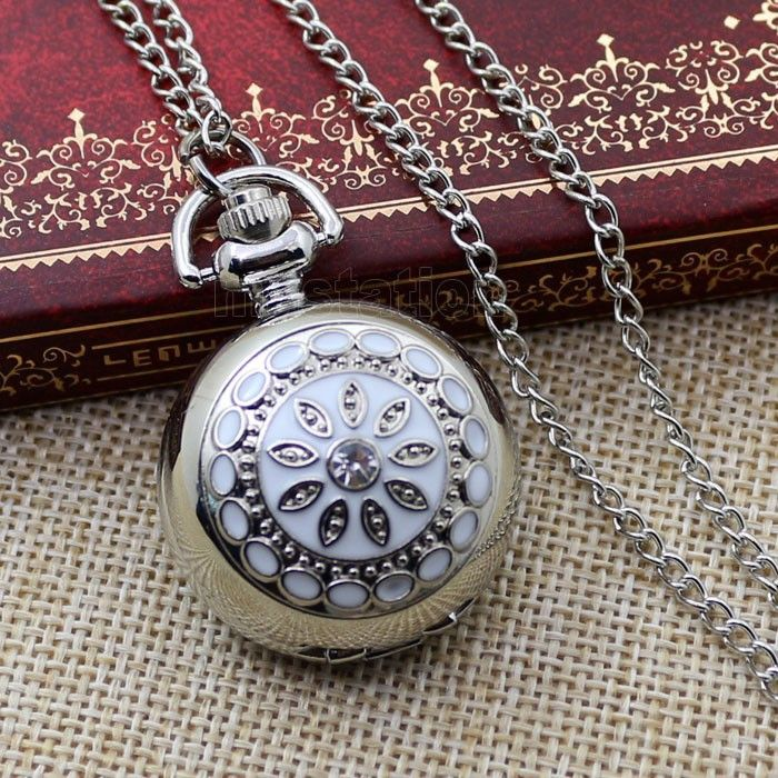 Very pretty white flower vintage style mini pocket watch necklace on a 30 inch chain. Case is high polished and mirrored. Back can be engraved for a personalized gift. Absolutely unique and lovely jew