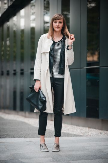 Cream Trench Coat Layered Over Leather Jacket and Striped Top with Straight Leg Trousers and Trainers #creamtrenchcoat #leatherjacket #stripedtop #straightlegtrouser #trainers #layering #classic #chic #withatwist #oversizedclutch #whitetrenchcoat #whitecoat #whitemac #creamtrenchcoat #creammac #creamcoat #leathertrousers #goldtrainers #bretontee #stripe #leather