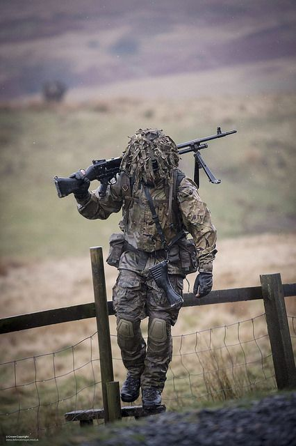 A soldier of the 1st Battalion The Duke of Lancasters Regiment (1LANCS) is pictured carrying a General Purpose Machine Gun (GPMG) during Exercise Border Storm at the Otterburn Training Ranges in Northumberland.