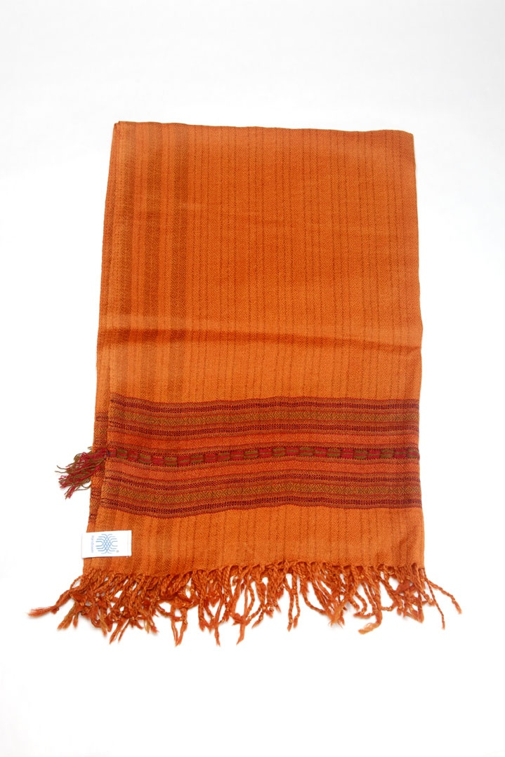 Shamshi -Named for a lovely mountain village in the Himalayan foothills, this stole adds a striking dash of beautifully rich, earthy orange to your wardrobe.