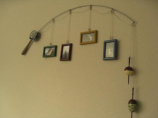Turn an old fishing rod into a fishermans showcase of family pictures. Good decor for a boys room. Super cute.