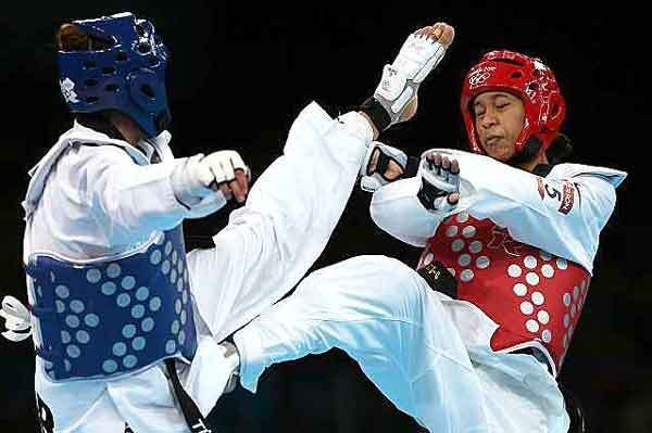 First-time Olympian Paige McPherson wins Bronze in taekwondo. Defeats taekwondo world champion & local favorite Sarah Stevenson of Britain. Ultimately, Pagie dominated Franka Anic of Slovenia, 8-3, in the 148-pound division for the Bronze Medal.