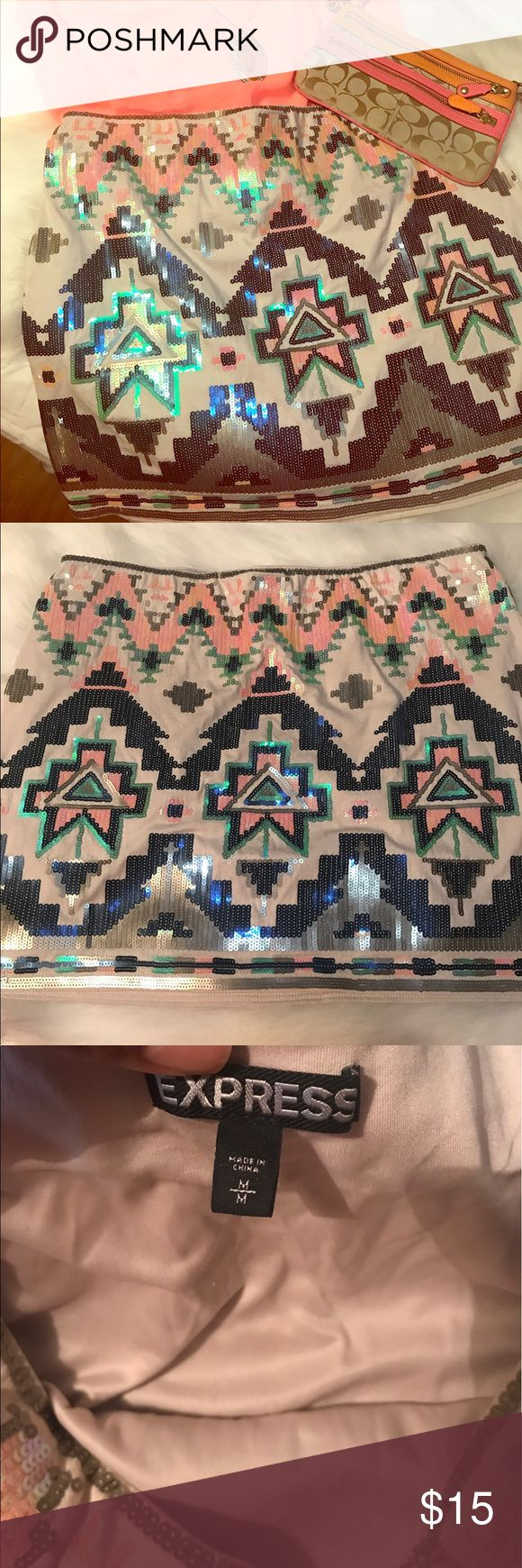 Express sequin skirt size M Beautiful Aztec sequin skirt. In excellent conditions no flaws. Express Skirts Mini