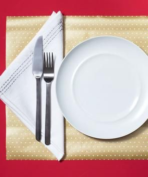 Wrapping paper as placemat. You can even write guests names on the edges to designate seats.