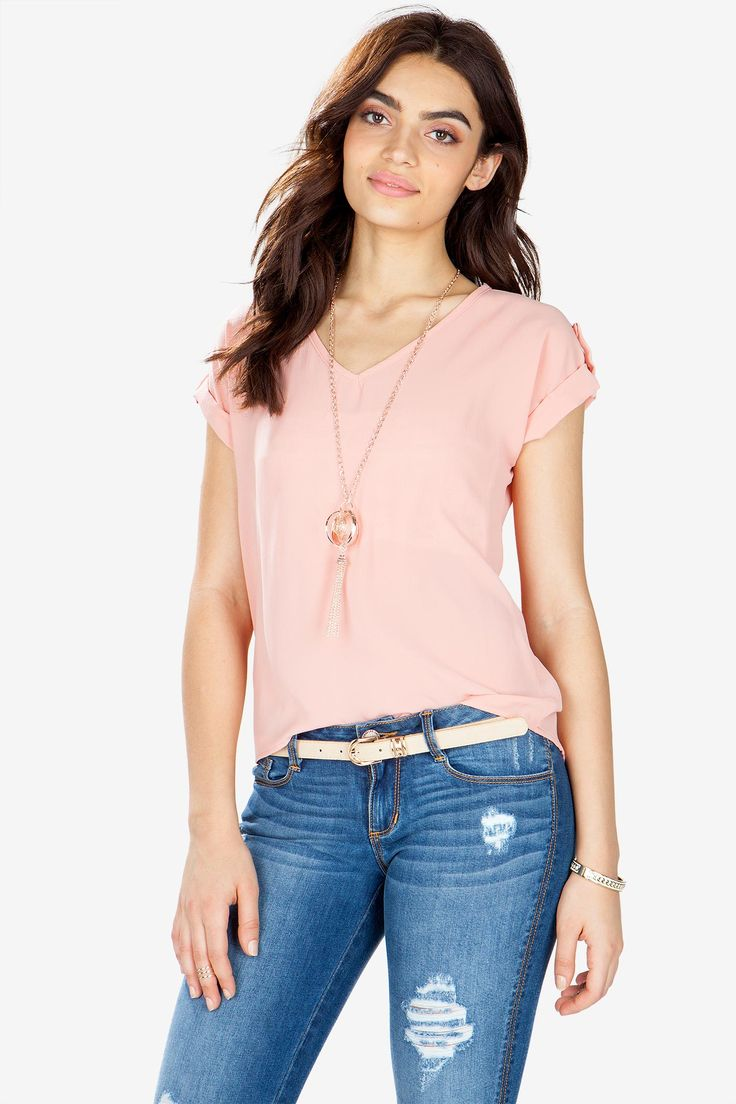 Pastel and pretty, this chiffon tee features an included gold drop necklace with tasseled multi-ring pendant. V-neck. Cuffed short sleeves. Lightly textured chiffon body. Decorative epaulets. Hi-lo hem. Semi-sheer. Necklace is removable. $18.50