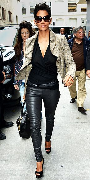 Edgy & chic! Love her taupe Roland Mouret transitional coat mixed with the black leather leggings.