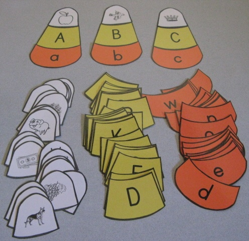 Learning Games: candy corn letters/word match. Also love the pumpkin numbers (1/one, etc) match on same page