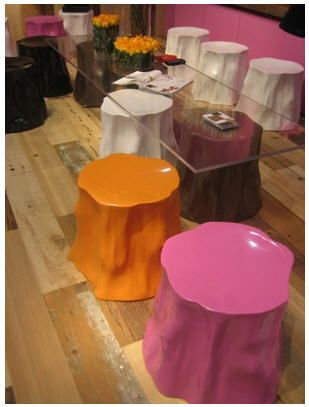 Try painting stump with epoxy garage floor paint to seal the wood. Then paint desired gloss color or metalic leaf.