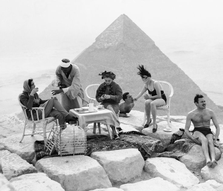 Tourists sunbathe and take tea at the top of the Great Pyramid. via @AOL_Lifestyle Read more: https://www.aol.com/article/news/2017/02/14/early-tourists-clambered-to-the-top-of-egypts-pyramids-in-fancy/21713136/?a_dgi=aolshare_pinterest#fullscreen