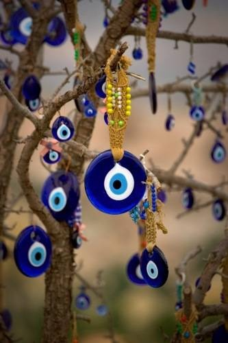 Evil Eye. Started with Turkish culture, now popular worldwide in many various cultures. It's NOT a religious thing, then it would be a sin if it was associated with it. But it's not, for Turks its cultural symbol! For others, it's fun nothing wrong with that!