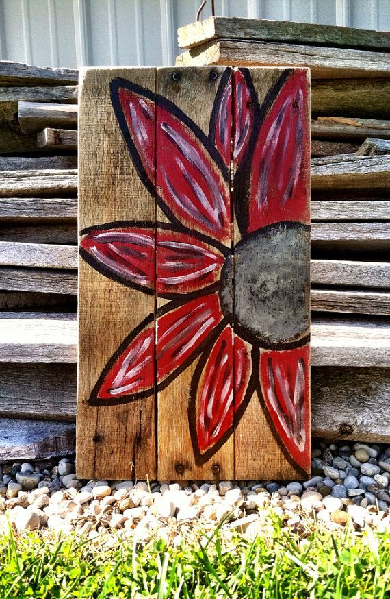 Daisy Pallet Sign    This rustic pallet sign is perfect to complete any look in your living room or on your entry table!    This sign is made from old pallet wood and is hand painted. It measures from about 10.5 X 18. Size may vary because of the wood. Wall hanger attached on the back.    *** Want a different color? Id love to customize this listing for you! ****    **** Want to see more? Check out my shop? https://www.etsy.com/shop/CharmingWillows?ref=si_shop ****