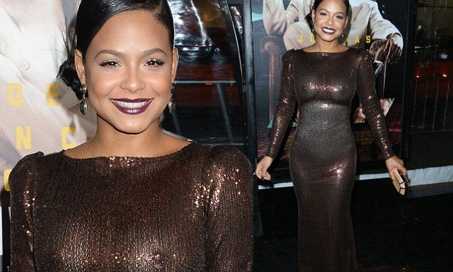 Christina Milian goes braless in sheer dress at Live By Night premiere