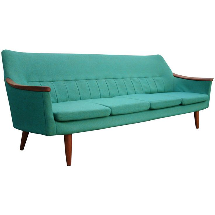Swedish Teak Sofa  1950  Svelte modern four seat sofa in teale upholstery with teak details.