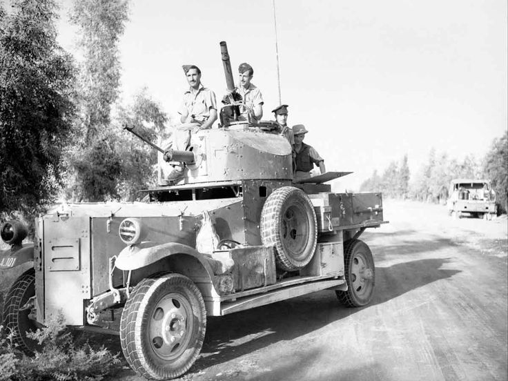 MAY  17 1941 Low level air attack in Iraq. A Fordson Armoured Car of No. 2 Armoured Car Company RAF, operating with 'Habforce', waits outside Baghdad, while negotiations for an armistice take place between British officials and the rebel government during the Iraqi Revolt. Label A Fordson Armoured Car of No. 2 Armoured Car Company RAF waits outside Baghdad, while negotiations for an armistice take place between British officials and the rebel government during the Iraqi Revolt, May 1941.