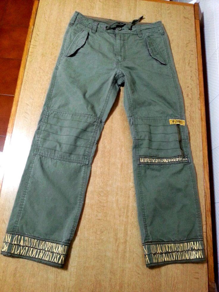 Pantaloni con decori dorati all'orlo e sul ginocchio - pittura su stoffa