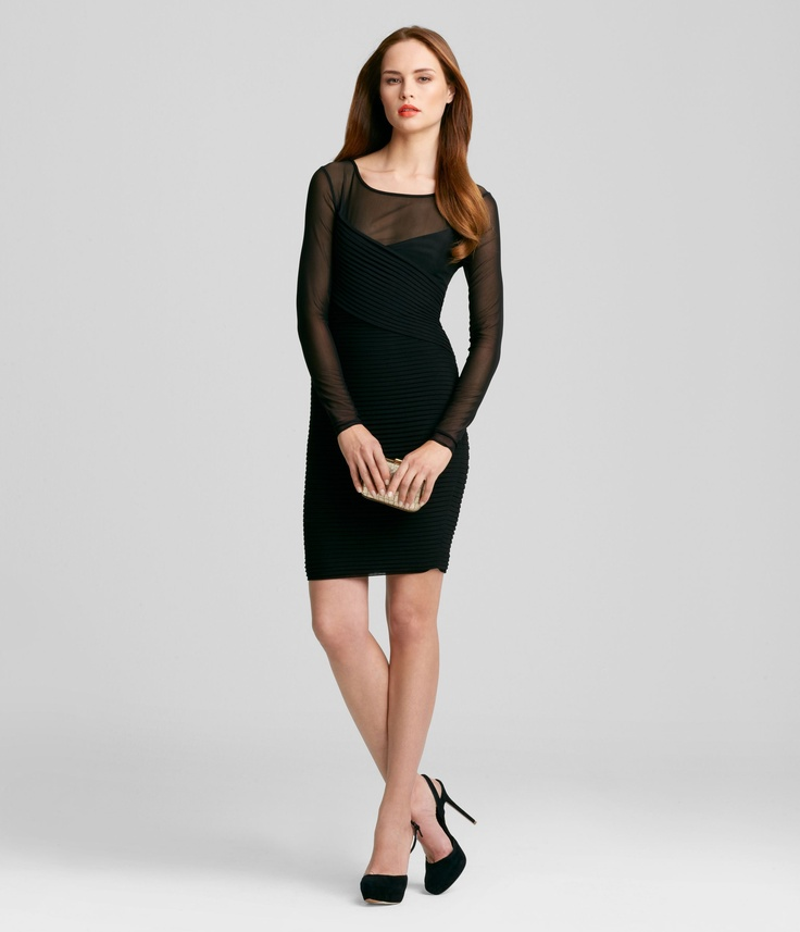 Spotlight your silhouette in this form accentuating, mesh sleeved Hilly Dress.