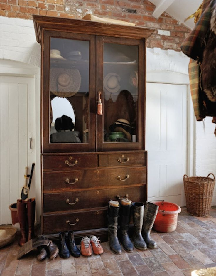 Love the brick floor, wood closet doors and the hutch for keeping things orderly. Perfect