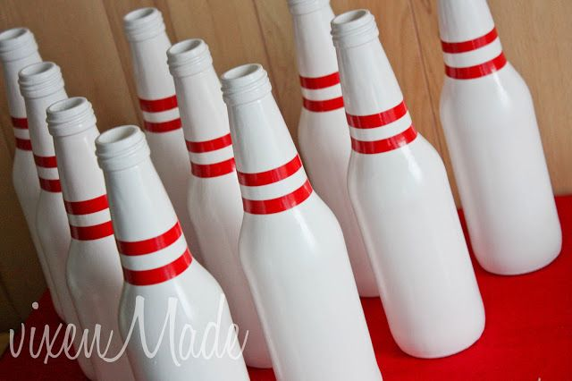 DIY bowling pins...painted bottles with red electrical tape