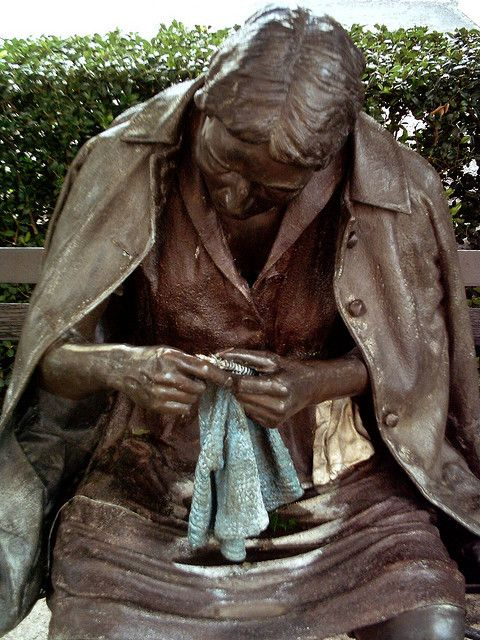 Statue of a knitter located in downtown Dallas, TX near the corner of Ross and Olive street near the Dallas Museum of Art.