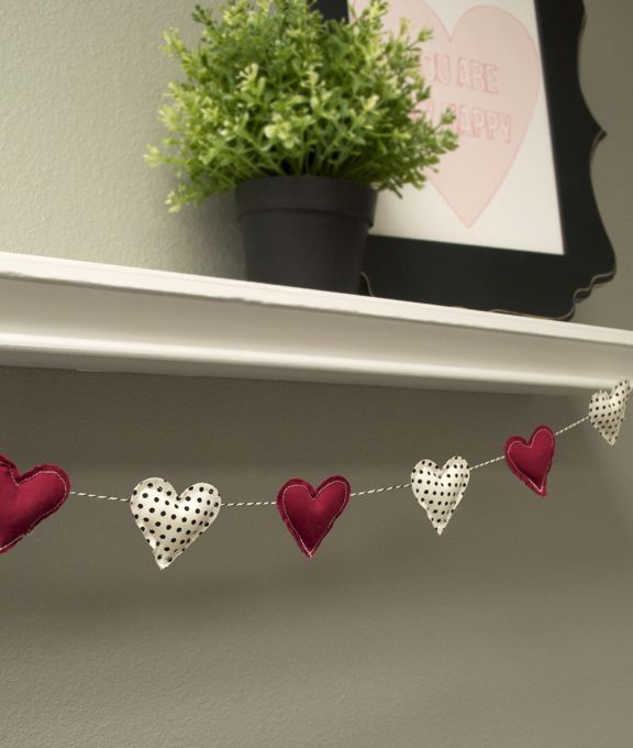 Hi there! Today I am going to show you how to make this fabric heart garland using one of my favorite features of the CAMEO... cutting fabric.