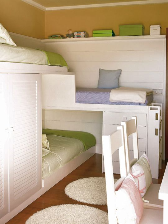 How do you fit three beds, a desk and two chairs into a typical sized bedroom? And did we mention adding a closet too? You make custom bunks that give each child their own little hideaway without feeling like they're being shoved in a corner. I love this!!! Going to need it very soon.