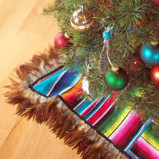 Bright colors and natural tones mix beautifully in this Christmas tree skirt made from a striped blanket with feather trim.