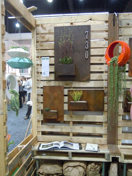 modern house #'s and planter  by Natalie Myers.  The metal gets the color with time.