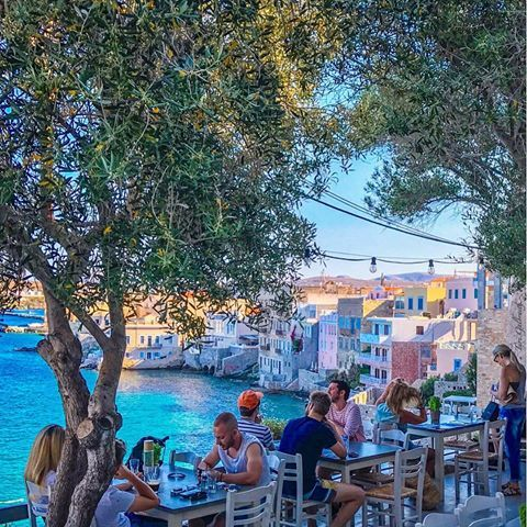"""Vaporia, a picturesque quarter of Ermoupolis, Syros, just past the port and capital city of this beautiful island was once home to wealthy ship owners and sea captains. The trading center of the island in the 19th century, deals were made in the shops and products loaded on ships to be exported. Here """"Sta Vaporia"""" restaurant has a stunning terrace overlooking the waterfront homes, boutique hotels and the sea. . . . . #exquisite_gre..."""