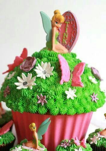 I have the giant cupcake mould. I could decorate the top half as the dress and stick a tinkerbell figuring in the centre! Hmmm …