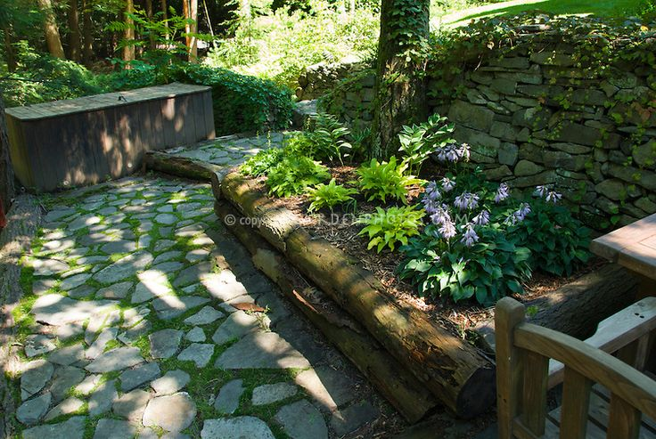 Raised garden bed in shade under trees with stone patio for Rock garden designs shade