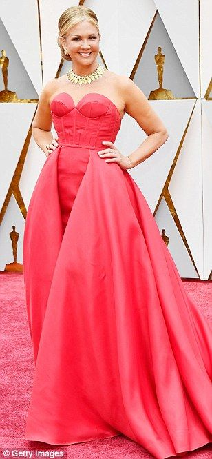 Hot pink for her: Entertainment news reporter Nancy O'Dell wore a strapless gown with a go...