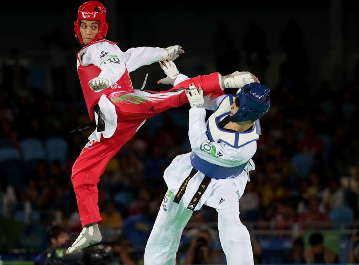 Ahmad Abughaush (JOR), red, and Daehoon Lee (KOR) compete in a men's taekwondo 68kg match at Carioca Arena 3 during the Rio 2016 Summer Olympic Games.