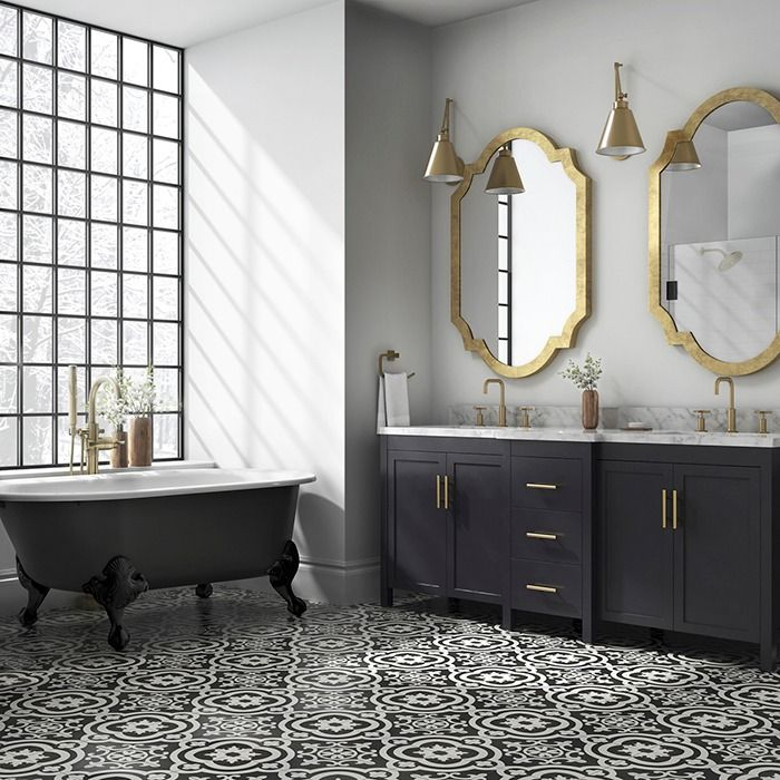 gorgeous matte cement tiles bring a playful sophistication into this master bathroom brass lighting and - Bathroom Inspiration