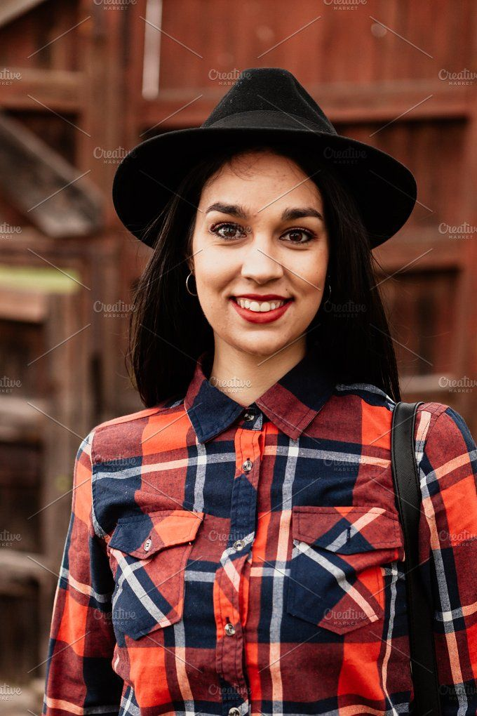 Attractive brunette girl Photos Pretty brunette girl with red plaid shirt and black hat by José Manuel Gelpi