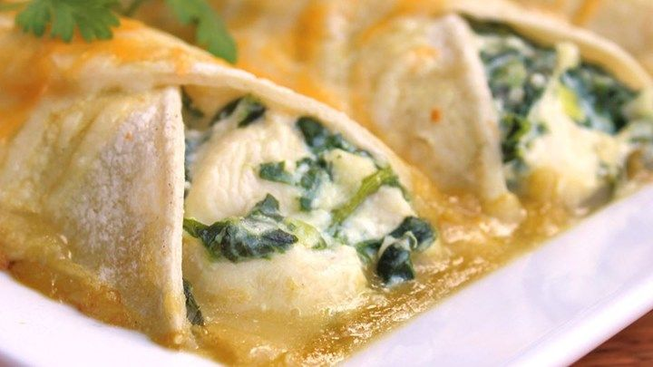 If you like spinach and Mexican food, you'll love these easy vegetarian enchiladas made with ricotta cheese and spinach.