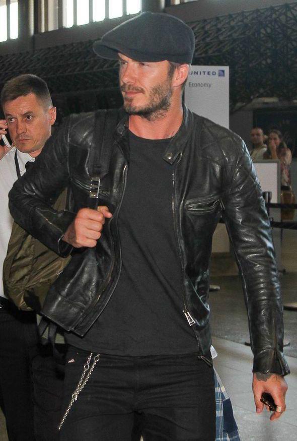 david beckham, brazil, flying home, stylish, black leather biker jacket, victoria beckham