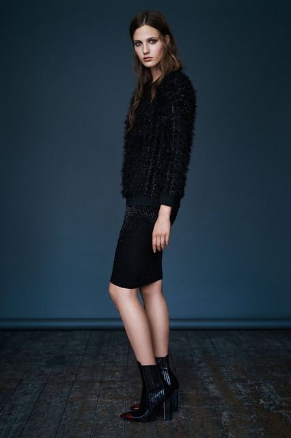 AllSaints Wire Sweat, $540, available at AllSaints; AllSaints Lovise Skirt, $305, available at AllSaints; AllSaints Cubista Boot, $505, available at AllSaints.