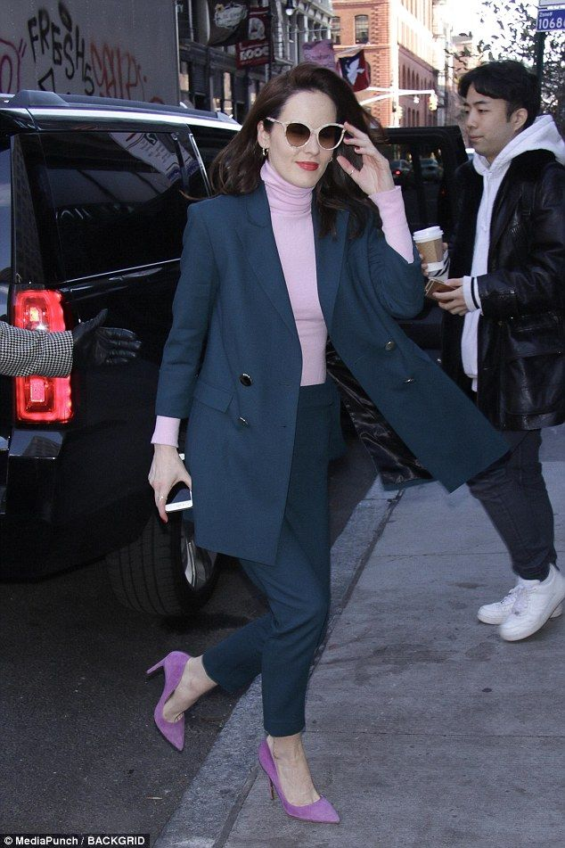 City chic! Michelle Dockery looked supremely stylish in an emerald pantsuit in New York Ci...