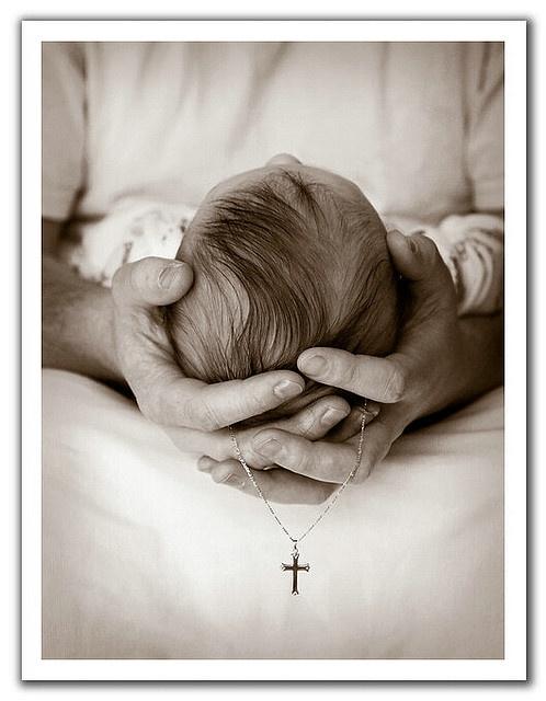 Love this photograph & juxtaposition. An infant's baptism.