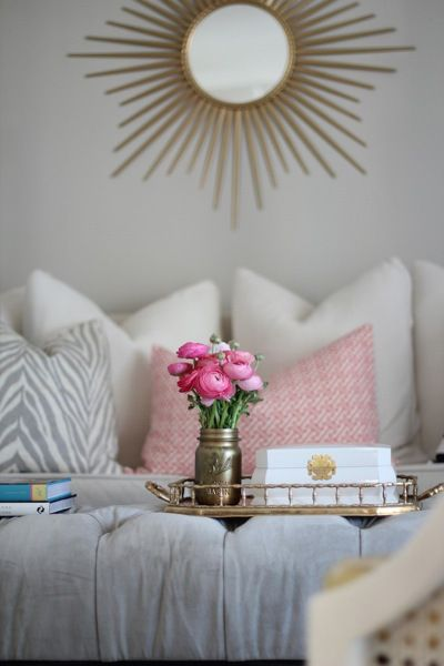 white living room with gray pink and gold