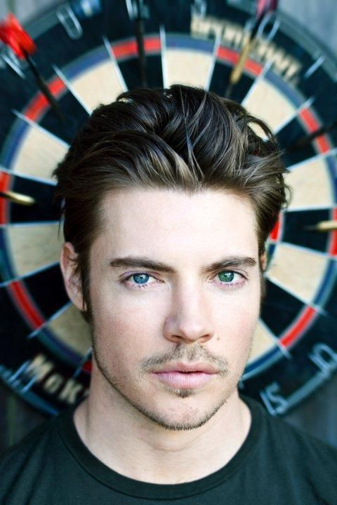Josh Henderson. He has one blue and one green eye. so sexy I can't stand it hahaa
