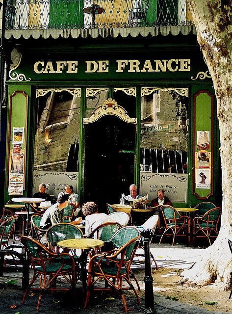 The colours and design of this cafe front certainly give the feeling of being in the Mediterranean. The emerald color is relaxing and inviting.