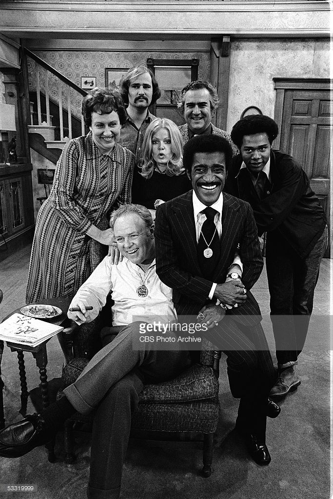 American entertainer Sammy Davis Jr. (1925 - 1990) (front left) appears with actors Carroll O'Connor (1924 - 2001) (center), (standing left to right) Jean Stapleton, Rob Reiner, Sally Struthers, Billy Halop (1`920 - 1976), and Mike Evans on the set of the CBS series 'All in the Family' during an episode entitled 'Sammy's Visit,' January 25, 1972 (the epsiode first aired on February 19th).