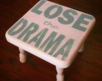 Rustic look meets modern lingo. This adorable time out stool reads Lose the Drama and is antiqued with a brown glaze to give that vintage and