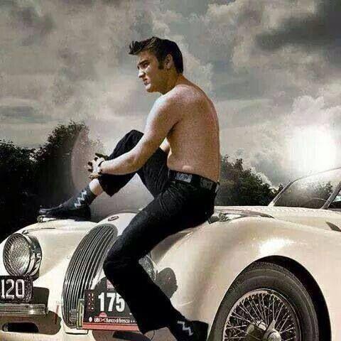 Elvis Presley sits on sports car