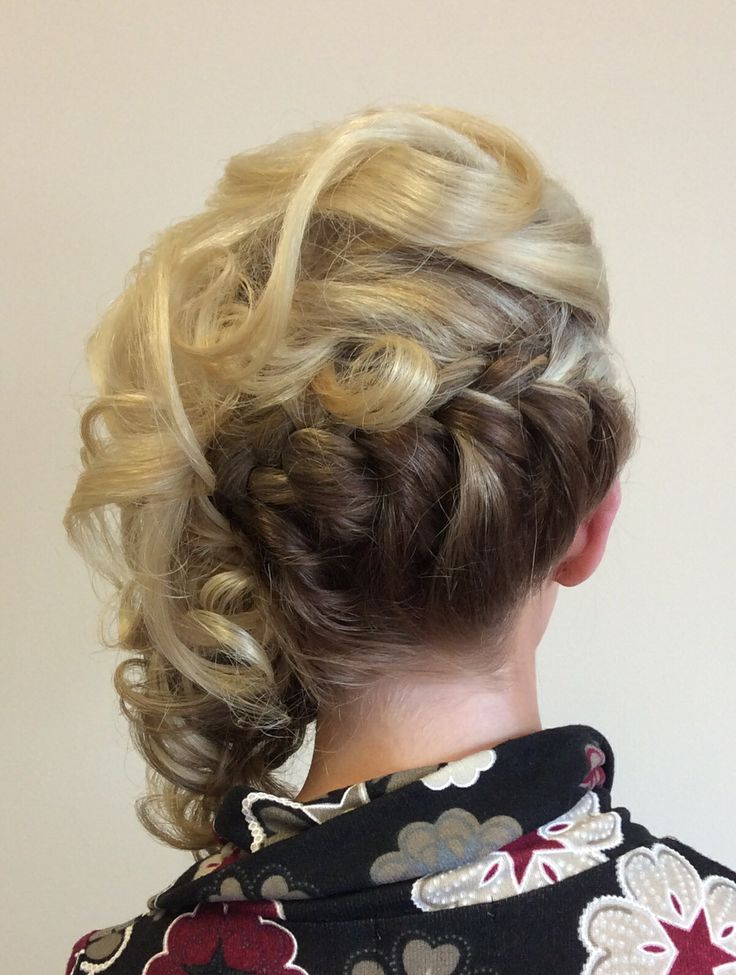 Large underneath plait with curls to one side
